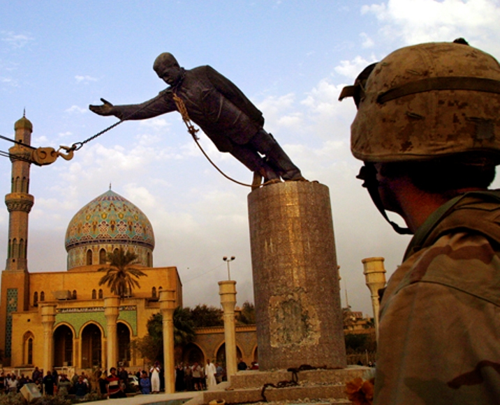 The Moment Of The Falling Of Saddam's Statue, With The Help Of The US Army.